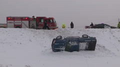 Car accident and truck rolled over in snowstorm on highway Stock Footage