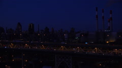 Night shot across the Queensboro Bridge with vehicle traffic and New York Stock Footage