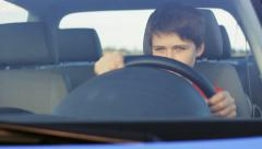Boy dreaming to be a driver Stock Footage