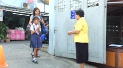 Students walk to school Stock Footage