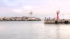 Fishermen on the breakwater Stock Footage