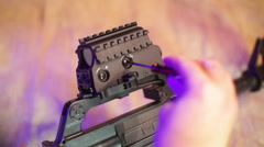 Adjusting sight on a rifle gun Stock Footage