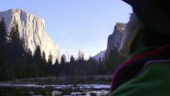 Woman Looks Up At The Majestic View Of El Capitan In Yosemite National Park Stock Footage