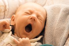 Little newborn baby girl lying Stock Photos
