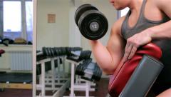 A man trains in a gym - stock footage