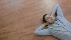 The man lies on the floor and dreaming - stock footage