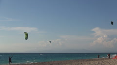 Kite surfing. Mediterranean island beach, colorful kites, hot summer day. - stock footage