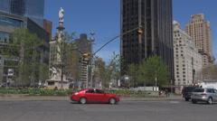 People commute traffic road Columbus circle New York City Manhattan NYC sunny US Stock Footage