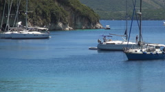 Yachts in Mediterranean bay. Beautiful sailing boats waiting in a harbor.  Stock Footage