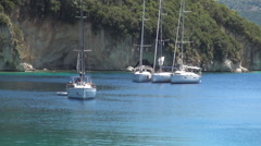 Beautiful sailing boats waiting in a harbor. Yachts in Mediterranean bay. Stock Footage