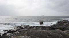 Sunny and stormy day by sea shore on senja Stock Footage