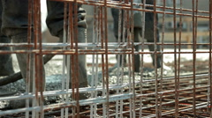 Workers pulling large hose for concreting slab of steel reinforced concrete. Stock Footage