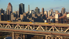 Traffic moves across the Queensboro Bridge with the New York skyline background. Stock Footage