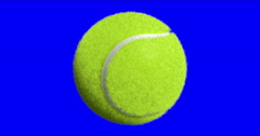 Spinning tennis ball on blue screen Stock Footage