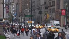 Busy Manhattan avenue traffic car pass New York City landmark downtown commute  Stock Footage