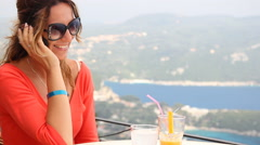 Woman talking on a mobile phone, sea vacation - stock footage