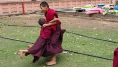 Novice Buddhist Monks Playing at the Mahabodhi Temple, Bodhgaya, Bihar, India Stock Footage