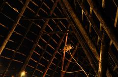 majestic old wooden stockfish structure at night time in the arctic circle - stock photo