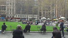 Business people take lunch One Bryant park terrace food outside New York City US Stock Footage