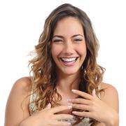 Front portrait of a funny fashion woman laughing hilarious - stock photo