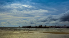 4K TimeLapse - Moving clouds over a sea port Stock Footage