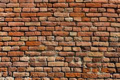 orange old brick wall - stock photo
