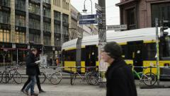 Street life at Berlin district Mitte at Hackscher Markt Stock Footage