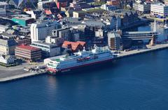 Stock Photo of travel ship vessel hurtigruten at port/harbour in tromsoe city