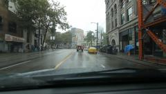 Stock Video Footage of Driving west on West Hastings Street. Rainy day in Vancouver, BC.