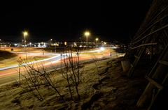 Car traffic on road at night creates beautiful shapes, lights and mood Stock Photos