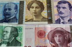 All Norwegian paper money currency from lowest to highest with focus on faces - stock photo