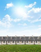 Row Of Cottages On Green Lawn Stock Illustration
