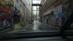 Driving down graffiti alley. Rainy day in downtown Vancouver, BC. Stock Footage