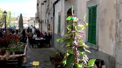 Spain Mallorca Island Sineu village 040 street cafe at border of weekly market Stock Footage