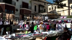 Spain Mallorca Island Sineu village 038 clothes market stall in old town scenery Stock Footage