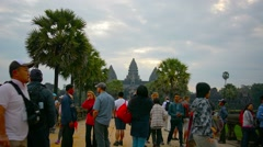 ANGKOR, CAMBODIA - CIRCA DEC 2013: Crowd of tourists standing and strolling o Stock Footage