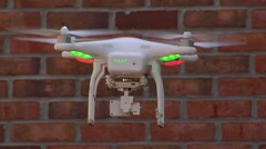 UAV-3, drone helicopter, CU flys w all indicator lights on Stock Footage