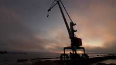 Freight Dock Crane Working at Sunset Time Time-Lapse Stock Footage