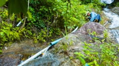 PHUKET, THAILAND - CIRCA DEC 2014: Local laborer repairing water system pipes - stock footage