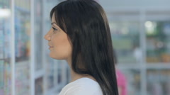 Young beautiful girl in drugstore Stock Footage