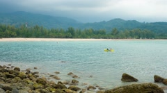 KAMALA, PHUKET, THAILAND - CIRCA JAN 2015: Foreign tourists in a rented kayak Stock Footage