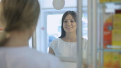 Pharmacist talking to a girl in a drugstore Stock Footage