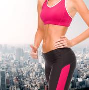 Close up of female abs and hand showing thumbs up Stock Photos