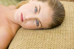 Young woman lying down Stock Photos
