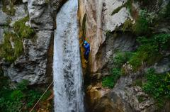 Athlete rappel down a waterfall Stock Photos