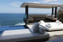 Infinity pool and sea - stock photo