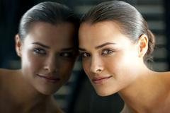 Woman's face in a mirror Stock Photos