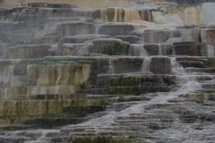 Terraced waterfall colored with sulfur Stock Photos