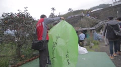 Man holding up green lantern - lantern festival Stock Footage