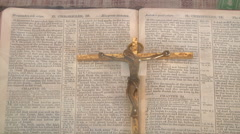 Cross and the book at Naggar in Himachal Pradesh, India. Stock Footage